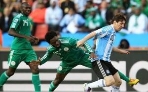 Haruna takes on Messi